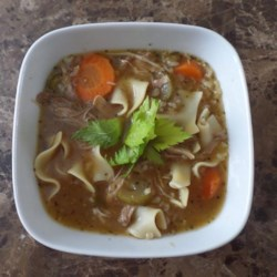 Leftover Turkey Soup (Slow Cooker) Recipe - Hearty turkey noodle soup made with leftover turkey in a slow cooker is a great meal for the day after Thanksgiving.