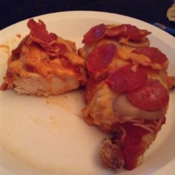 Pizza Chicken Recipe - Kick the flavor of ordinary breaded chicken breasts into a higher gear by topping them with pizza sauce, mozzarella cheese, and pepperoni.