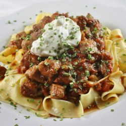 Porkolt (Hungarian Stew) Made With Pork Recipe - This recipe for Hungarian stew made with pork loin and bacon is seasoned with paprika and served over egg noodles.
