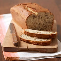 Favorite Banana Bread Recipe - Cream cheese makes this classic banana bread unbelievably moist. No wonder it's a favorite!