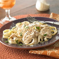 Fettuccine Alfredo with Chicken Recipe - Creamy sauce, succulent chicken, perfectly al dente pasta, a sprinkle of fresh herbs . . . all that's missing is the waiter and the check.