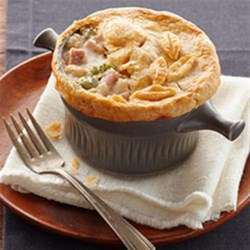 Ham and Cheese Pot Pie Recipe - Warm ham and cheese go together like broccoli and cauliflower. And we've put that in the mix, too. Our hearty, creamy pot pie looks restaurant-worthy and tastes even better.