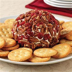 Classic ROKA Cheese Ball Recipe - Take a trip down memory lane! This Classic ROKA Cheese Ball, studded with dried cranberries and chopped pecans, tastes as good as you remember.