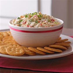 Creamy Crab and Red Pepper Spread Recipe - Sweet, tender lump crabmeat in a creamy spread with green onions and red peppers makes for an upscale appetizer spread.