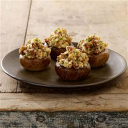 Sausage Stuffed Mushrooms Recipe - This Johnsonvillle recipe is a must for mushroom fans! The taste of Johnsonville Italian Sausage pairs well with cream cheese, Parmesan cheese, lemon and garlic to create a dish that's bound to please! These stuffed mushrooms are perfect for an appetizer when you're entertaining family and friends.