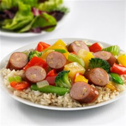 Johnsonville(R) Apple Chicken Sausage Sweet and Sour Stir Fry Recipe - Smoky apple chicken sausage, fresh vegetables, and sweet pineapple are combined with a sweet and sour sauce to create a delicious rice dish.