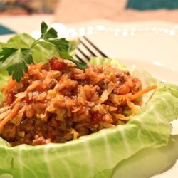Golompke (Beef and Cabbage Casserole) Recipe - A bag of slaw mix from the produce section, ground beef, and rice are featured in this delicious and easy casserole that tastes like cabbage rolls.