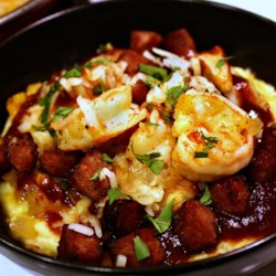 Shrimp and Grits With Kielbasa Recipe - Tender pink shrimp team up with savory kielbasa sausage and polenta in an easy version of shrimp and grits that makes a great main dish for a fancy brunch.