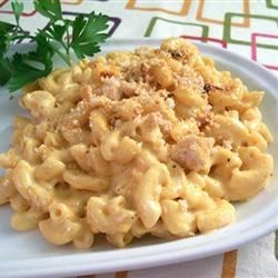 Cafeteria Macaroni and Cheese Recipe - A creamy casserole of macaroni and Cheddar cheese gets a wake-up call from mustard, Worcestershire sauce and a dash of hot sauce. Cheese, buttery bread crumbs and paprika are sprinkled over the top.