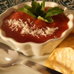 Tomato Soup II Recipe - Tomatoes are slowly cooked with onions and celery, then pureed and strained and cooked again with seasonings to make a thick, smooth soup.