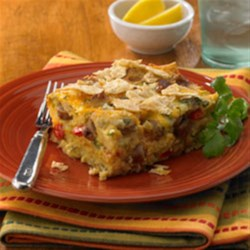 Mexican Tortilla Breakfast Casserole Recipe - This dish takes the traditional casserole and adds elements of Mexican cuisine and your favorite breakfast ingredients.  Onion, bell pepper, garlic, green chilies and cilantro add bold, authentic flavors to the dish. For a tasty bonus, crushed tortillas are used to give this recipe a fun and playful texture. Together with eggs and Johnsonville Hot & Spicy Breakfast Sausage Links you've got a winning combination that'll take the boredom out of breakfast.