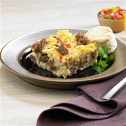 Sunrise Casserole Recipe - This egg, sausage, hash brown, and cheese casserole with colorful veggies is refrigerated overnight then baked in the morning.