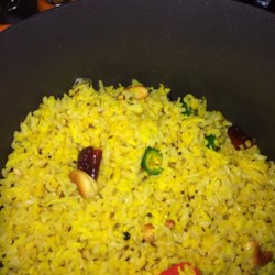 Khara Pongal Recipe - This classic south Indian lentil dish combines dried red chilies and fresh green chile peppers with coconut and cashews.