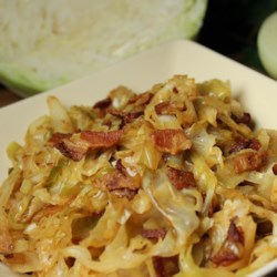 Fried Cabbage with Bacon, Onion, and Garlic Recipe - This is a side dish where the title says it all. Cabbage is fried with bacon, onion, and garlic for a side dish you'll want to eat again and again.