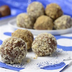 Peanut Butter Apple Bites Recipe - Kids and adults alike will love these easy-to-prepare one-bite snacks made with apple butter, peanut butter, graham cracker crumbs and cinnamon rolled in chopped peanuts.