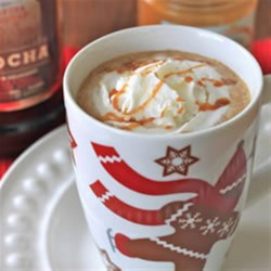 Kahlua White Chocolate Latte Recipe - This hot mocha drink with Kahlua Mocha and white chocolate liqueur is topped with whipped cream, caramel sauce, and a hint of sea salt.