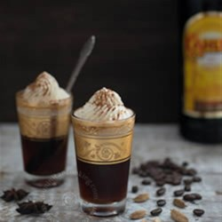 Spiced Winter Coffee Recipe - Coffee with cardamom and star anise is mixed with Kahlua and topped with whipped cream for a warming winter brew.