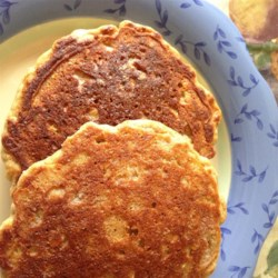 Multigrain Pancakes Recipe - Easy, satisfying, and full of whole grain goodness! Top as desired- I like mine with peanut butter and sugar-free syrup. Also, any chopped fruit, nuts, or chocolate chips could be added to the batter.