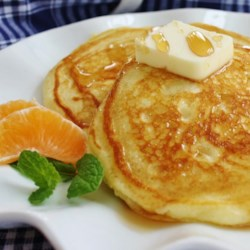 Fluffy and Delicious Pancakes Recipe - Fluffy pancakes made with homemade soured milk taste like cake and are best served with butter, syrup, and whipped cream.