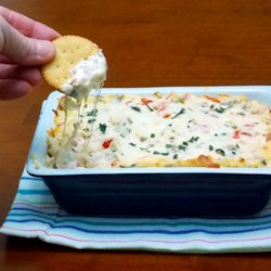 RITZ White Pizza Meatball Dip, created by Lombardi's Pizza Recipe - This recipe takes some favorite pizza toppings and turns them into a great party food! Served hot with RITZ Crackers, this creamy dip is easy to make. You can use pre-made meatballs or make your own, and with a few added Italian spices, this dip will become a staple at all of your get-togethers.