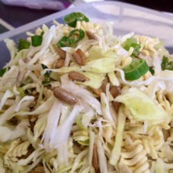Napa Slaw Recipe - Chopped napa cabbage, crunchy pieces of ramen noodle, and sunflower seed kernels make a unique Asian-type slaw with a sweet and tangy vinegar dressing.