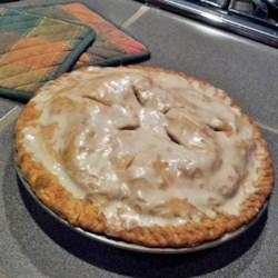 Glazed Apple Cream Pie Recipe and Video - This double crust pie has a cream filling topped with cinnamon laced apples. To finish, a simple glaze is poured over the warm pie. Serve chilled for best results.