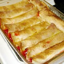 Cherry Enchiladas Recipe - Cherry Pie like you've never had it before! Cherry pie filling wrapped in flour tortillas, soaked overnight in a sweet liquid, then baked.  I used to work at a bed and breakfast, and we would make this sometimes for catered luncheons. I added my own touch with the almonds.