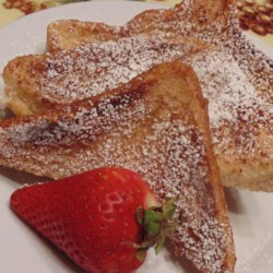 Incredibly Sweet and Aromatic French Toast Recipe - Enjoy this aromatic and sweet French toast with a dusting of confectioners' sugar.