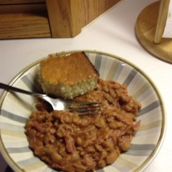 Best Ever Pinto Beans Recipe - This hearty pinto bean dish uses smoked ham hock to add flavor and richness. A bit of tomato sauce and brown sugar gives this meal a little zing.
