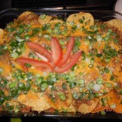 Sour Cream Chicken Enchilada Casserole Recipe - This sour cream chicken enchilada casserole is layered with tortilla chips underneath a creamy chicken layer, topped with shredded cheese, and baked into a nacho-inspired meal.