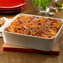 Baked Smoked Sausage Spaghetti Casserole Recipe - Cooked spaghetti is baked with cheese in a saucy tomato blend of sausage slices, garlic, bell pepper and mushrooms.