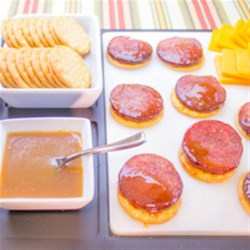 Honey Dijon Glazed Summer Sausage Recipe - Sliced summer sausage is baked with a sweet honey and dijon mustard glaze for an easy appetizer or snack.