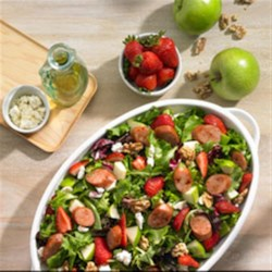 Johnsonville Strawberry and Apple Chicken Sausage Salad Recipe - Give your taste buds a sweet ride with this light, refreshing salad. Delicious strawberries, tart apples, feta cheese, walnuts and Johnsonville's Apple Chicken Sausage create a sweet and savory combo--a delicious and healthy way to enjoy your favorite sausages.