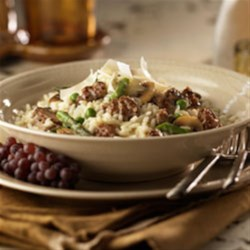 Sausage and Vegetable Risotto  Recipe - Enjoy the delicious flavors of restaurant dining in the comforts of your home. Johnsonville brings you this stunning risotto dish that's bound to please the most demanding taste buds. The asparagus, mushrooms and peas add great textures to the creamy risotto. The Johnsonville Italian Sausage adds the flavor that makes this dish a winner.