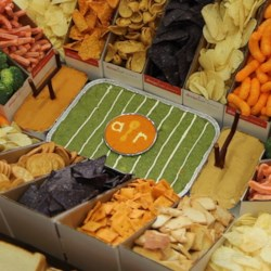 Pile High Snack Stadium Recipe - Impress all your football watching friends with a snack stadium made with sandwiches, chips, veggies, and dips. It is a guaranteed touchdown!