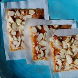 Almond Bars II Recipe - These bars are made with a graham cracker crust and topped with an almond and toffee flavored mixture.