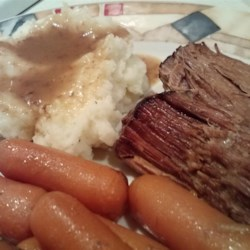 Roast in a Slow Cooker Recipe - Make dinner preparation a breeze by using this slow cooker pot roast recipe using cream of mushroom soup and prepared gravy for a savory main course.