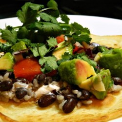 California Tacos Recipe - Crispy tortillas layered with black beans, rice, fresh tomatoes, and avocado are similar to tacos in California and are easy to prepare.
