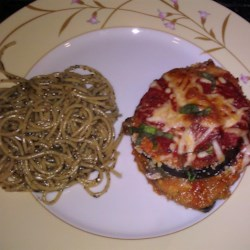 Healthier Eggplant Parmesan II Recipe - Eggplant slices are dipped in egg whites and whole wheat bread crumbs, then baked instead of fried, creating a healthier version of the traditional dish.