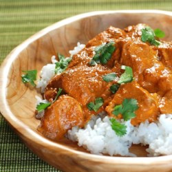 Punjabi Chicken in Thick Gravy Recipe - Chicken legs simmer in a thick curry gravy in this recipe for a delicious main course with just the right amount of spiciness to it.