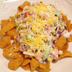 Frito(R) Corn Salad Recipe - A colorful corn salad made with bell peppers and onions tossed with a creamy dressing receives an extra crunch with the addition of Fritos(R).