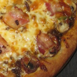 Mel's Brown Pizza Sauce Recipe - This tomato-based pizza sauce is seasoned with pepper, basil, onion powder, celery salt, seasoned salt, and garlic to create a complex and delicious flavor.