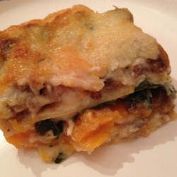 Butternut Squash Lasagna Recipe - Butternut squash is roasted and layered with spinach, a homemade white sauce, and mozzarella cheese creating a vegetarian comfort food for the fall.