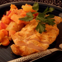 Golden Vegetable Chicken Recipe -  Spicy cayenne and turmeric enhance the flavor and emphasis the color of the carrots and sweet potato in this chicken vegetable bake.  Tomatoes, potatoes and onions complete the dish.
