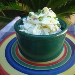 Creamy Apple Slaw Recipe - This creamy apple slaw has cabbage, carrots, and apples folded together with a yogurt-based ranch dressing perfect for summer picnics.