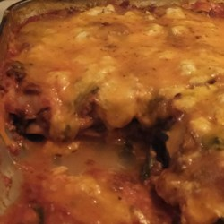 Spinach and Beef Lasagna Recipe - Filled with ground beef, spinach, cheese, and tomato sauce, this spinach beef lasagna is hearty and delicious.