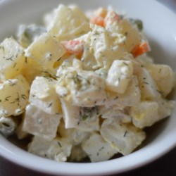 Argentinean Potato Salad Recipe - A classic South American potato salad, also known as 'Ensalada Rusa,' that contains chopped green olives and mixed vegetables with a little kick of lemon and ground mustard.
