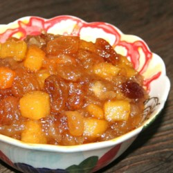 Spicy Persimmon Chutney Recipe - A tangy relish that's a nice variation on the more traditional cranberry sauce. Originally submitted to ThanksgivingRecipe.com.