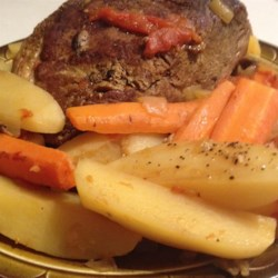 Pot Roast with Vegetables Recipe - Beef chuck roast simmers for hours with potatoes, carrots, and mushrooms for a one-dish meal that will make your house smell wonderful. Use the pan juices for gravy.