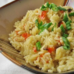 Tasty Spicy Rice Pilaf Recipe - Roasted red pepper, onion, garlic, and mushrooms turn plain rice into a spectacular side dish.